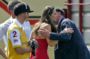In 2006, Kate attends a charity polo match to support the prince (in yellow). Here, she greets Will's Private Secretary Jamie Lowther-Pinkerton.