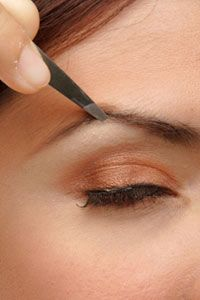 Tweezing may be a cheap way to shape eyebrows, but is it worth the time and trouble? See more pictures of personal hygiene practices.