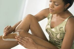 Waxing may be painful, but it lasts much longer than shaving or hair removal creams. See more pictures of personal hygiene practices.