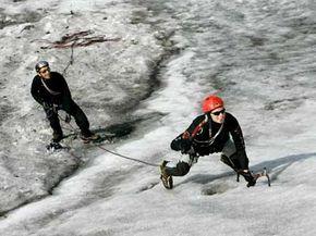 Ice climber Dietmar Scherz climbs a glacier while Christian Stransky belays him at Rettenbachgletscher in Soelden, Austria.