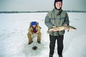 Fishing Image Gallery These fishermen on Lake Riley, Minn. know ice fishing is as much about socializing as it is about catching fish. See more fishing pictures.