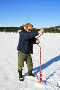 Drilling the hole to fish disturbs the ice and can be dangerous.