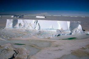 Tabular iceberg grounded in frozen sea ice in Antarctica