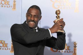 """Actor Idris Elba in the press room with the Best Performance by an Actor in a Mini-Series or a Motion Picture Made for Television award for """"Luther,"""" at the 69th Annual Golden Globe Awards in 2012."""