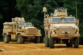 A Category I (left) and Category II Mine Resistant, Ambush Protected vehicle (MRAP) drive through an off-road course during a demonstration in Aberdeen, Md. There's been a huge demand for the vehicles in Iraq.