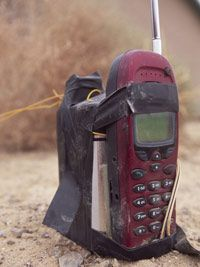 A cordless phone is a popular remote trigger for an IED since it may allow a signal to be transmitted up to a mile.