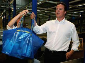 Conservative Party leader David Cameron shows off his reusable Ikea shopping bag.