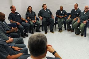 Inmates, who have spent most of their lives behind bars, gather to talk about surviving on the outside. Studies show that native-born Americans are jailed at about twice the rate of immigrants, refuting the myth that immigrants commit more crime.