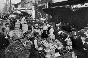 A view of the Maxwell Street Market in Chicago, ca. 1915. The Maxwell Street neighborhood in Chicago was a haven for new arrivals from the mid-1800s.