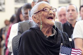 Juana Hernandez, age 101, smiles as she looks upward at a video presentation during her swearing-in ceremony for U.S. citizenship on Dec. 29, 2015 in Miami.