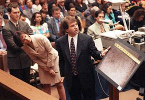 Defense attorney Barry Scheck shows the jury a picture of a second shoe imprint that he believes could be that of a second assailant during the O.J. Simpson murder trial in Los Angeles.