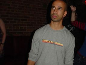 An agent wearing a Ghosts of Pasha shirt he made using the logo from the band's Web site