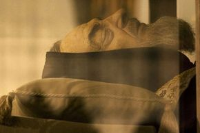 Saint Padre Pio, who died in 1968, was exhumed in 2008 and found to be intact enough to be canonized. Although he was outfitted with a silicone mask (shown), physicians at his exhumation testified his face was not badly decomposed.