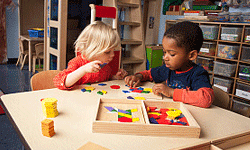 Kindergarteners learn that working together can make a task more fun.