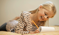 Your second grader has moved beyond writing her name to writing real stories, with beginnings, middles and ends.