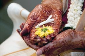 Intricate patterns of mehndi applied to a bride before a wedding.