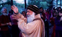 Bhagwan Shree Rajneesh leads his disciples in a devotional ritual in 1984.