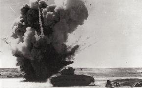 A Nazi German bomb narrowly misses a British Matilda II tank in North Africa.