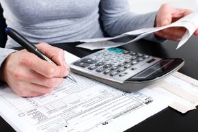 You can file form 8379 with your tax return or on its own.