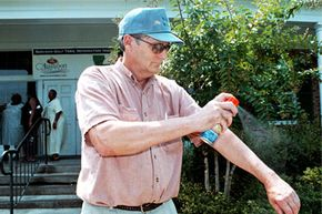 Phil Bethell sprays on mosquito repellent during a stop at the Greenwood, La., tourist center in 2002. If he were using sunscreen and repellent, it would be a good idea to apply the sunscreen first (and reapply it later).