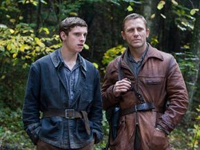 """Jamie Bell and Daniel Craig on the set of """"Defiance."""""""