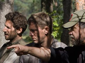 """Mark Feuerstein and Daniel Craig take direction from Edward Zwick on the set of """"Defiance."""""""