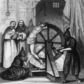 Circa 1500, A prisoner undergoing torture at the hands of the Spanish Inquisition. Monks in the background wait for his confession with quill and paper.
