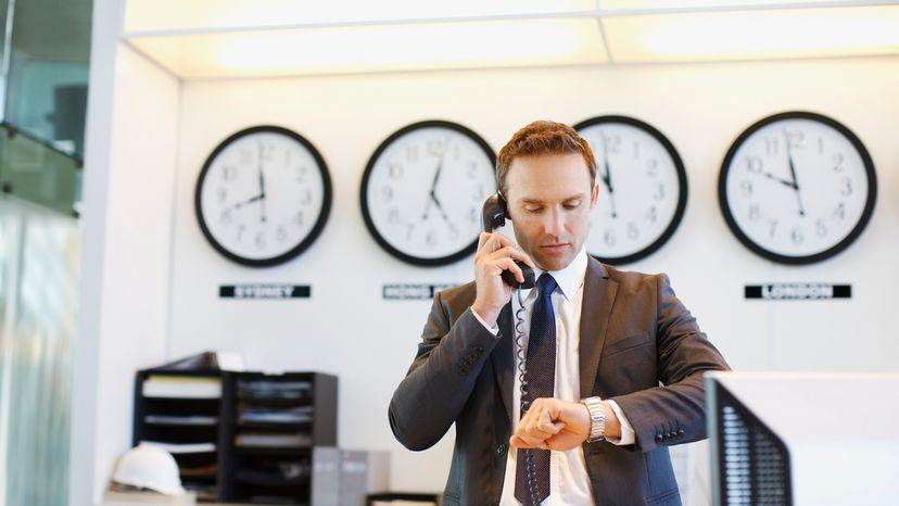 Man Making an International Call in Office