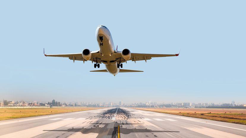 airplane over runway