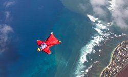 Wingsuit flyers, like the one pictured, need to jump out of an airplane or off a cliff to fly.