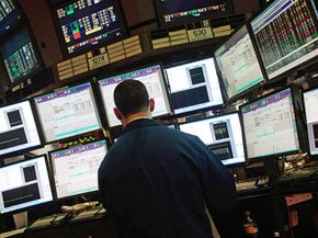 A financial professional monitors stocks at the New York Stock Exchange on March 31, 2009.