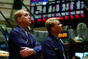 Traders watch Treasury Secretary Timothy Geithner detail his financial recovery plan on the floor of the New York Stock Exchange in February 2009.