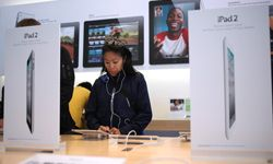 A customer looks at the new iPad 2 at an Apple Store in San Francisco, Calif.