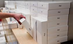 Boxes of the new Apple iPad 2 are stacked as it goes on sale in London, England.
