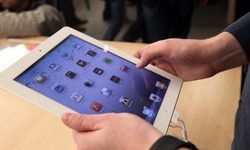 A customer tries out the new iPad 2 shortly after it went on sale at the Fifth Avenue Apple store in New York City.