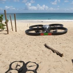 The AR.Drone has two available outer hulls, one better for outside use, the other optimized for indoor flying. This photo shows one of them in action.