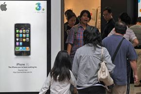 Customers in Hong Kong wait in line to buy the 3G iPhone.