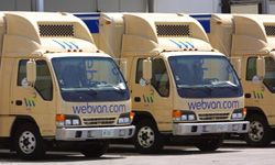 Webvan trucks sit outside an Illinois distribution center on July 10, 2001 -- the day after the popular company shut its doors for good.