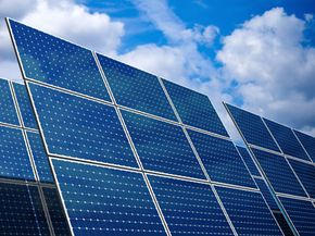 Solar cells are made of silicon, which holds electrons loosely enough to be knocked loose by photons.