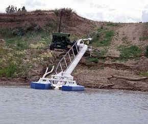 Because the water level of the river varies, farmers along the Missouri River use floating pumps like this one to collect irrigation water.