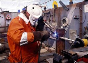 A contestant working with one of the MIG welders