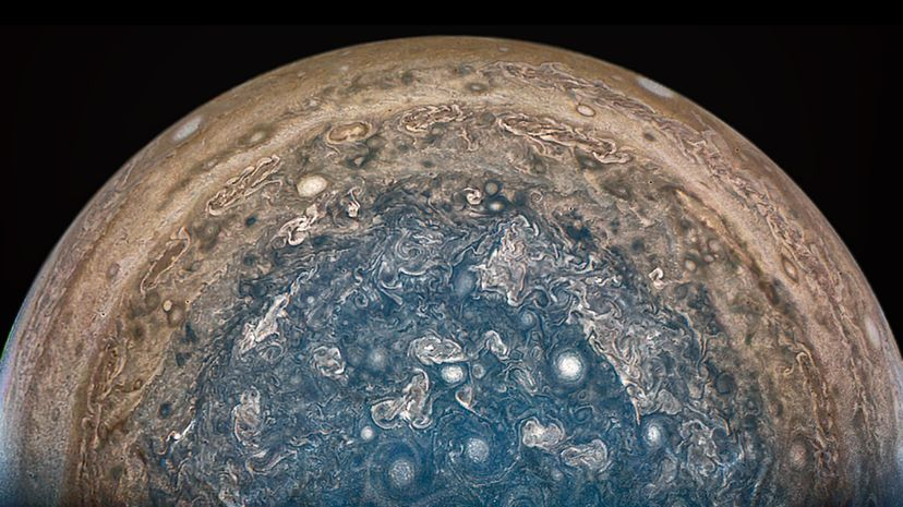 """The Juno spacecraft has spent time at Jupiter's south pole, sending images back from """"beneath"""" the planet. NASA/JPL-Caltech/SwRI/MSSS/Betsy Asher Hall/Gervasio Robles"""