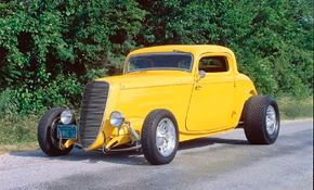 Jake's Coupe features a narrowed 1937 Ford truck grille. See more hot rod pictures.