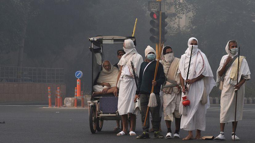 Jain monks crossing road in India