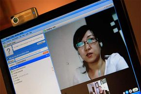 From her home office in the U.S. Dr. Danille Drake talks with Jing Jing Huang, a psychiatrist in China, during their weekly Skype call. Dr. Drake supervises Jing Jing Huang as she learns Freudan psychoanalysis.