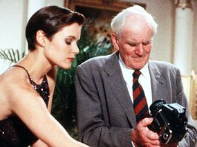 """Carey Lowell as Bond Girl Pam Bouvier and Desmond Llewelyn as the original """"Q"""" in the 1989 film """"License to Kill"""""""