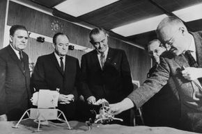 James Webb (far left), with Vice President Hubert Humphrey, President Lyndon B. Johnson, Dr. Hugh L. Dryden and Dr. Homer E. Newell at a briefing on the progress of the U.S. space program in 1965.