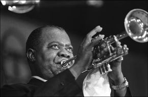 Louis Armstrong performs in Paris in 1965.