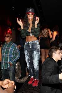 Singer Ciara's pair of acid washed jeans fits her hip-hop persona.