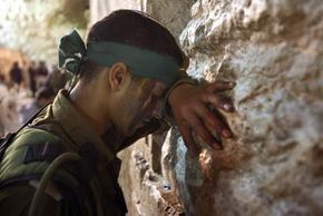 Mental Disorder Pictures An Israeli soldier prays at the Western Wall.
